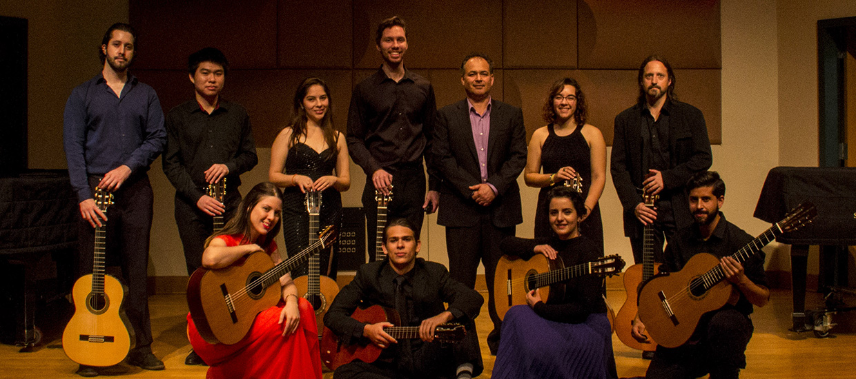 Classical Guitar Ensemble pose for a group picture with their guitars