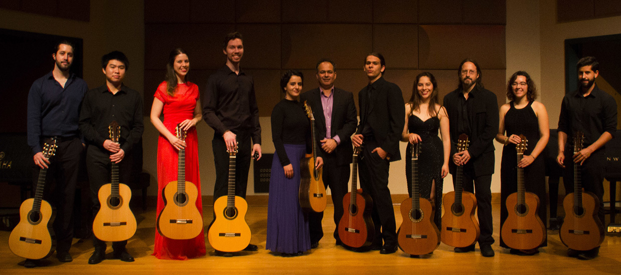 Classical Guitar Ensemble pose for a picture with their guitars before an event at the University of Miami