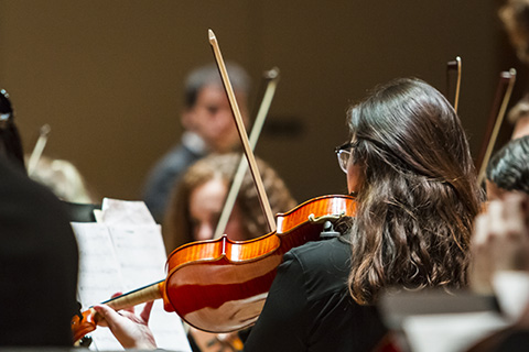 Violinist plays during an event at the University of Miami