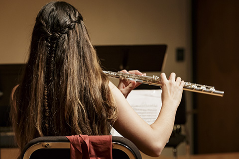 Musician plays the flute in the Stamps Woodwind Quintet
