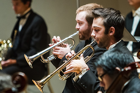 Trumpet players are performing during an event at the University of Miami