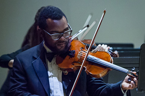 Violinist plays with the FROST Symphony Orchestra